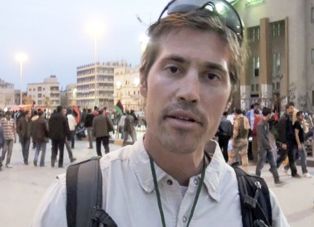 This undated file still image from video released April 7, 2011, shows James Foley of Rochester, N.H., in Benghazi, Libya. In a horrifying act of revenge for U.S. airstrikes in northern Iraq, mili ...