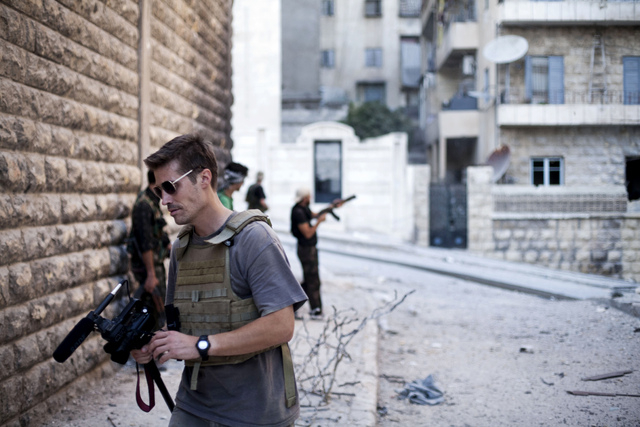 This September 2012 file photo posted on the website freejamesfoley.org shows journalist James Foley in Aleppo, Syria. In a horrifying act of revenge for U.S. airstrikes in northern Iraq, militant ...