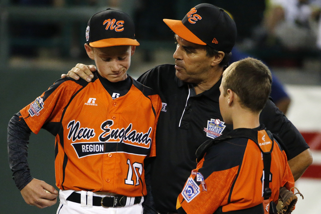 Cumberland manager David Belisle, center, talks with pitcher CJ Davock, left, and catcher Trey Bourque during the fifth inning of an elimination baseball game against Chicago at the Little League  ...