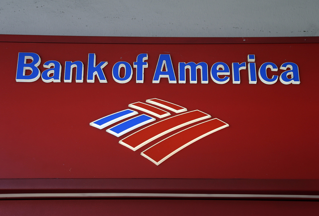 FILE - This, Oct. 14, 2012,  file photo shows a Bank of  America branch in downtown Miami. How much will Bank of Americas expected $17 billion mortgage settlement cost the company? The answer is,  ...