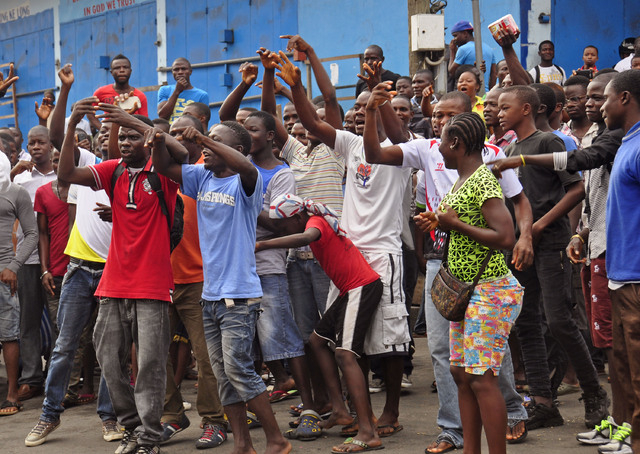 Residents from an area close to the West Point Ebola center protest as they are not allowed to enter the area leading to their homes after Liberia security forces blocked roads. The government has ...