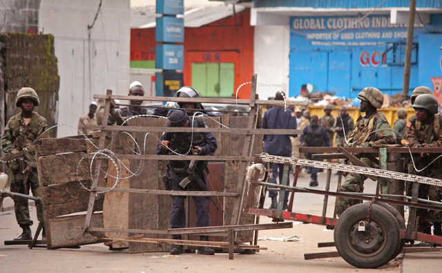 Liberia security forces block a road near the West Point Ebola center as the government clamps down on the movement of people to prevent the spread of the Ebola virus in city Monrovia, Liberia, We ...