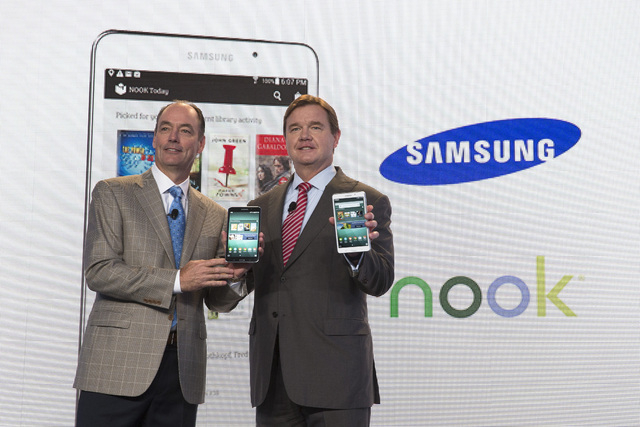 Tim Baxter, president of Samsung Electronics America, left, and Mike Huseby, CEO of Barnes & Noble, pose for a photograph during the unveiling of the Samsung Galaxy Tab 4 Nook, a co-branded tablet ...