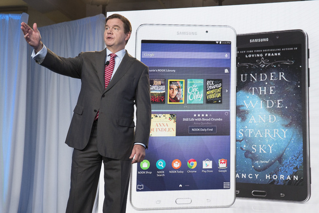 Mike Huseby, CEO of Barnes & Noble, speaks during the unveiling of the Samsung Galaxy Tab 4 Nook, a co-branded tablet that will replace B&N's Nook, Wednesday, Aug. 20, 2014, in New York. The 7-inc ...