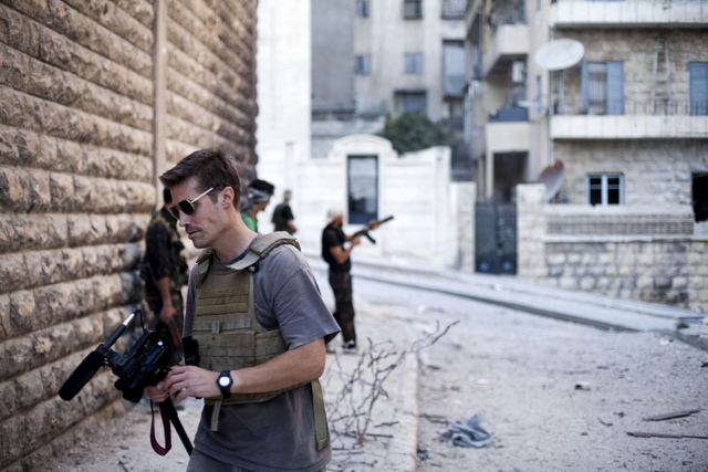 This September 2012 file photo posted on the website freejamesfoley.org shows journalist James Foley in Aleppo, Syria.In a horrifying act of revenge for U.S. airstrikes in northern Iraq, militants ...