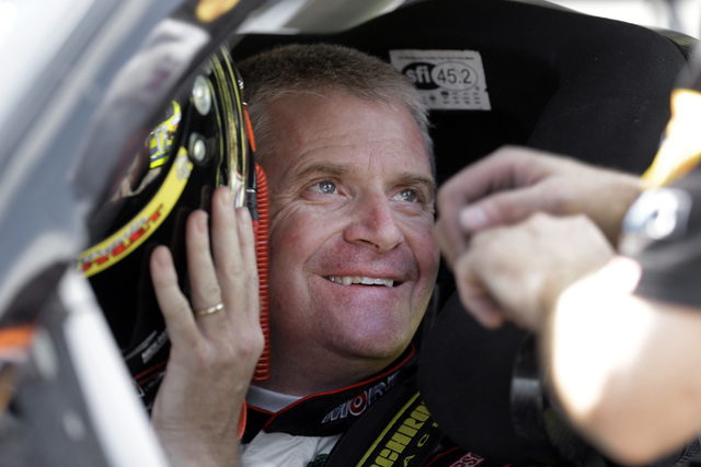 "Jeff Burton prepares to qualify for the NASCAR Sprint Cup Series auto race at Michigan International Speedway in Brooklyn, Mich., Friday, Aug. 15, 2014. A ""grieving"" Tony Stewart will sk ..."