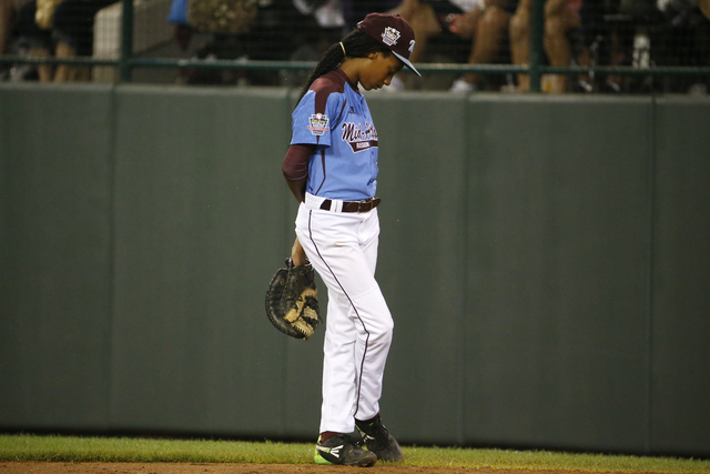 Philadelphia pitcher Mo'ne Davis stands at first base after being removed as pitcher in the third inning of a United States semi-final baseball game against Las Vegas at the Little League World Se ...