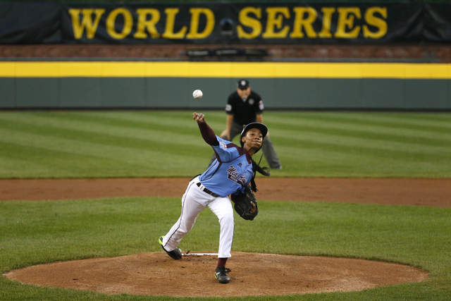 Philadelphia pitcher Mo'ne Davis delivers in the first inning of a United States semi-final baseball game against Las Vegas at the Little League World Series tournament in South Williamsport, Pa., ...