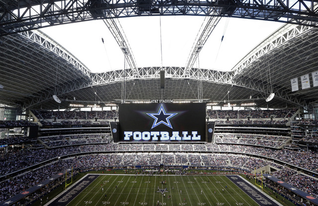 In this Nov. 3, 2013, file photo, the roof is open on the stadium before an NFL football game between the Dallas Cowboys and the Minnesota Vikings in Arlington, Texas. Forbes says Cowboys are the  ...