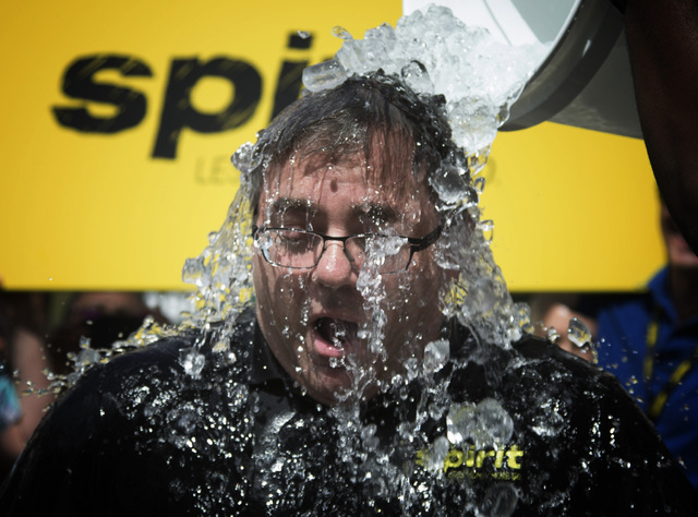 Spirit Airlines President and CEO Ben Baldanza takes the Ice Bucket Challenge at the company's Miramar, Fla. headquarters Aug. 18, 2014. Baldanza said he lost his mother to ALS and wanted to help  ...