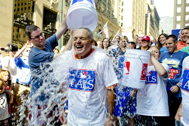Major League Baseball Commissioner-elect Rob Manfred participates in the ALS Ice-Bucket Challenge outside the organization's headquarters in New York Aug. 20, 2014. Manfred participated with more  ...