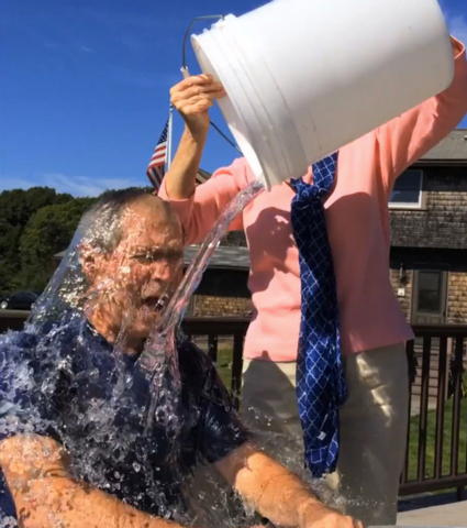 In this image from video posted on Facebook, courtesy of the George W. Bush Presidential Center, former President George W. Bush participates in the ice bucket challenge with the help of his wife, ...