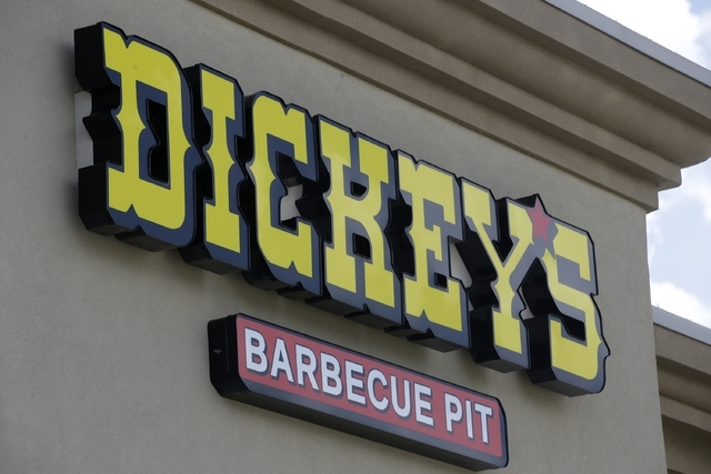 This Aug. 14, 2014, file photo, shows a sign at Dickey's Barbecue Pit in South Jordan, Utah. As prosecutors mull whether charges are warranted against employees at the Utah restaurant where a woma ...