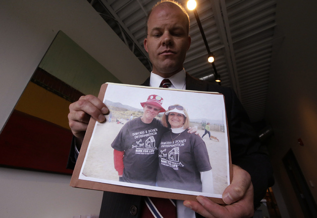 Attorney Paxton Guymon holds a photograph of Jim and Jan Harding following a news conference Thursday, Aug. 21, 2014, in Salt Lake City. Jan Harding, 67, drank sweet tea containing a toxic cleanin ...