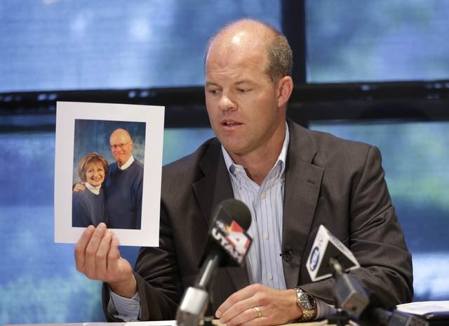 Attorney Paxton Guymon holds a photograph of Jim and Jan Harding during a news conference in Salt Lake City on Thursday, Aug. 14, 2014. Jan Harding, 67, remains hospitalized but was upgraded from  ...