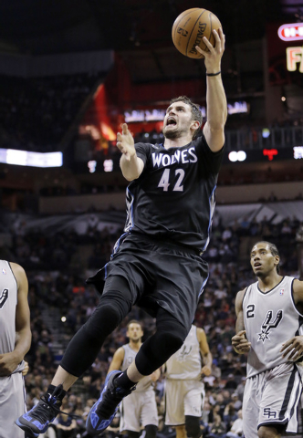 In this Jan. 12, 2014, file photo, Minnesota Timberwolves' Kevin Love (42) shoots against the San Antonio Spurs during the second half on an NBA basketball game in San Antonio. The Timberwolves, C ...
