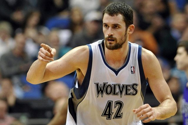 In this Jan. 16, 2012, file photo, Minnesota Timberwolves' Kevin Love reacts during the second half of an NBA basketball game against the Sacramento Kings in Minneapolis. The Timberwolves, Clevela ...
