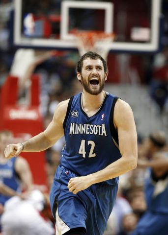 In this Nov. 19, 2013, file photo, Minnesota Timberwolves forward Kevin Love (42) reacts in the second half of an NBA basketball game against the Washington Wizards in Washington. The Timberwolves ...