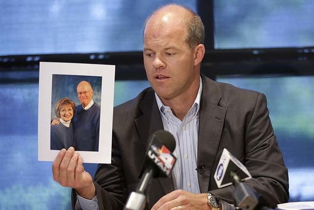 Attorney Paxton Guymon holds a photograph of Jim and Jan Harding during a news conference in Salt Lake City. Jan Harding, 67, who nearly died after unknowingly drinking iced tea mixed with chemica ...
