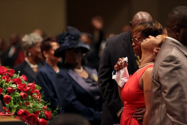 Lesley McSpadden is comforted during the funeral services for her son Michael Brown on Monday, Aug. 25, 2014, at Friendly Temple Missionary Baptist Church in St. Louis. Hundreds of people gathered ...