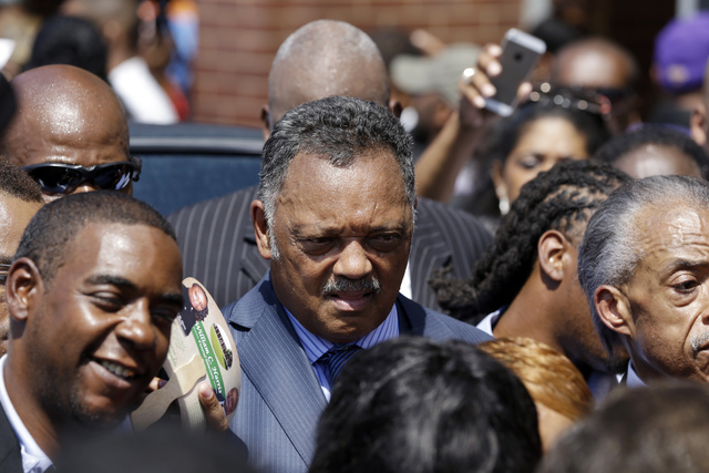 Rev. Jesse Jackson attends the funeral for Michael Brown Monday, Aug. 25, 2014, in St. Louis. Brown, a black 18-year-old who was unarmed, he was shot Aug. 9 by Officer Darren Wilson, who is white. ...