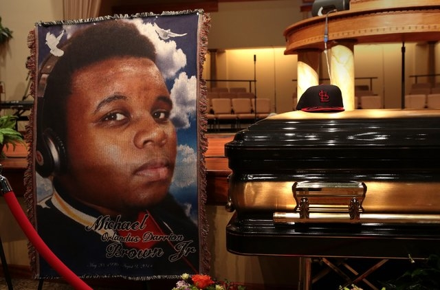 The casket of Michael Brown sits inside Friendly Temple Missionary Baptist Church awaiting the start of his funeral on Monday, Aug. 25, 2014. Brown, who is black, was unarmed when he was shot Aug. ...