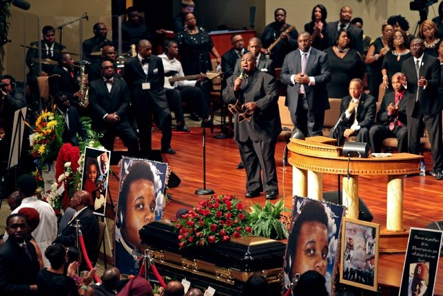 Funeral services for Michael Brown are held on Monday, Aug. 25, 2014, at Friendly Temple Missionary Baptist Church in St. Louis. Hundreds of people gathered to say goodbye to Brown, who was shot a ...