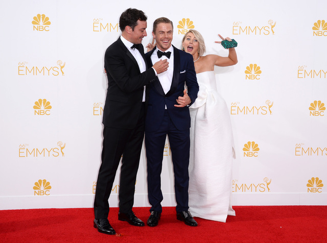 Jimmy Fallon, from left, Derek Hough and Julianne Hough arrive at the 66th Annual Primetime Emmy Awards at the Nokia Theatre L.A. Live on Monday, Aug. 25, 2014, in Los Angeles. (Photo by Jordan St ...