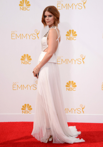 Kate Mara arrives at the 66th Annual Primetime Emmy Awards at the Nokia Theatre L.A. Live on Monday, Aug. 25, 2014, in Los Angeles. (Photo by Jordan Strauss/Invision/AP)