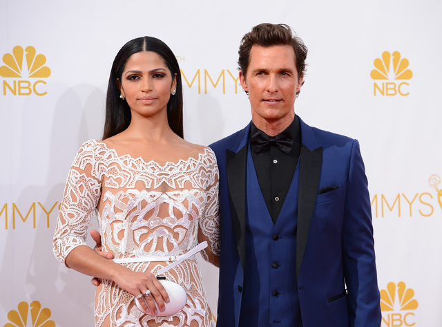 Camila Alves, left, and Matthew McConaughey arrive at the 66th Annual Primetime Emmy Awards at the Nokia Theatre L.A. Live on Monday, Aug. 25, 2014, in Los Angeles. (Photo by Jordan Strauss/Invisi ...