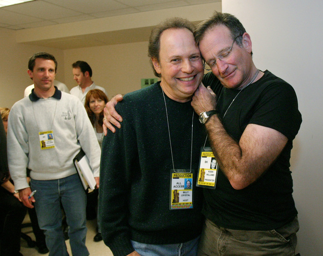 In this Feb. 28, 2004 file photo, Oscar host Billy Crystal, center, and presenter Robin Williams, right, joke around after a writers' meeting for the 76th annual Academy Awards in Los Angeles. (AP ...