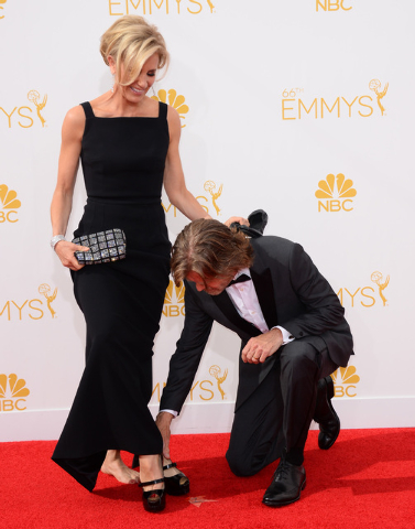 Felicity Huffman, left, and William H. Macy arrive at the 66th Annual Primetime Emmy Awards at the Nokia Theatre L.A. Live on Monday, Aug. 25, 2014, in Los Angeles. (Photo by Jordan Strauss/Invisi ...