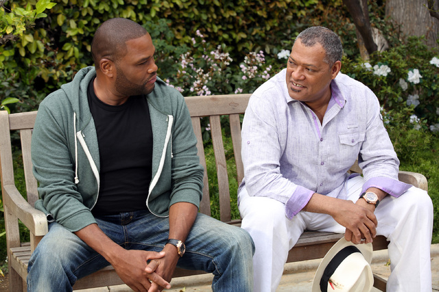 """This image released by ABC shows Anthony Anderson, left, and Laurence Fishburne in a scene from the comedy """"Black-ish,"""" premiering Sept. 24. (AP Photo/ABC, Adam Taylor)"""