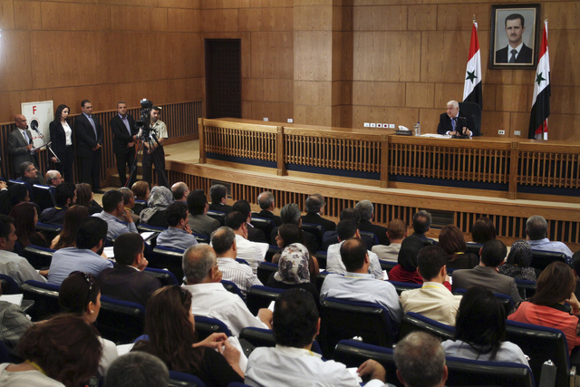Syrian Foreign Minister Walid al-Moallem speaks during a press conference, giving the first public comments by a senior Assad official on the threat posed by the Islamic State group, in Damascus,  ...