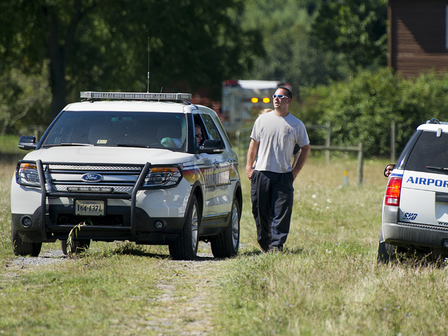 Augusta County Sheriff's deputy Jeremy McManaway, center, talks with another emergency responder at a staging area close to the scene where an Air Force F-15C fighter jet based in Massachusetts cr ...