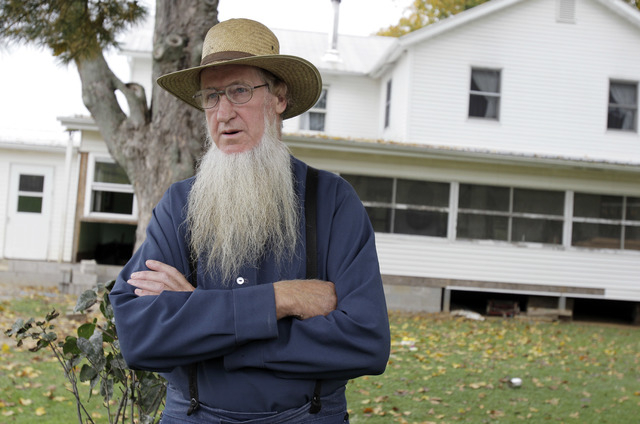 Sam Mullet stands in front of his Bergholz, Ohio, home on Oct. 10, 2011. An appeals court on Wednesday, Aug. 27, 2014, overturned the hate-crime convictions of 16 Amish in beard- and hair-cutting  ...