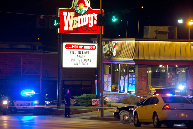 "In this Tuesday, Aug. 26, 2014 photo, Omaha police are on the scene of an officer-involved shooting in Omaha.  A suspect was shot dead and a crewman with the ""Cops"" television show was wounded.  ( ..."