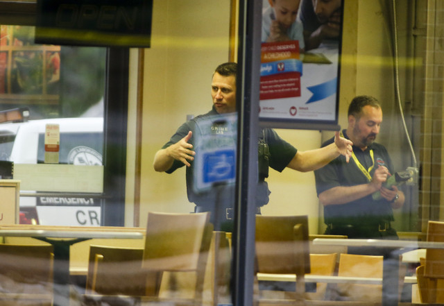 "Clime lab technicians sweep a Wendy's in Omaha, Neb., for evidence, Wednesday, Aug. 27, 2014. Police say a suspect has been killed and a crew member with the ""Cops"" television show has b ..."