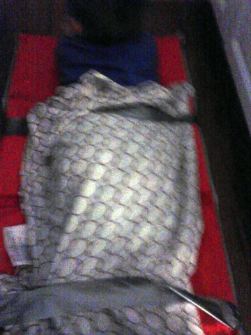 This undated photo provided by Jeffrey Rasansky at Rasansky Law Firm shows a student taped to a nap mat at Heart2Heart Montessori Academy in Willow Park, Texas. (AP Photo/Courtesy of Jeff Rasansky)