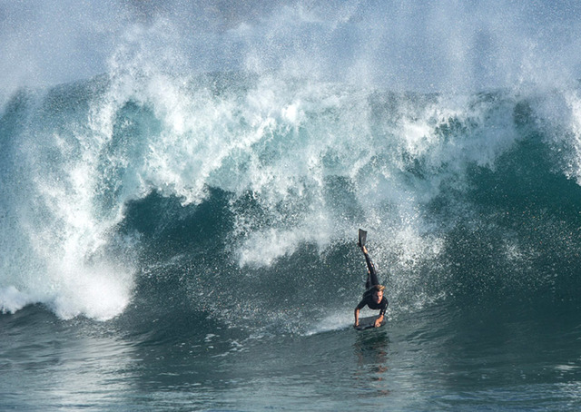 A belly boarder takes on a big wave at the Wedge in Newport Beach, California, on Tuesday, Aug. 26, 2014. Southern California coastal communities have been inundated by a surge of rising seawater  ...