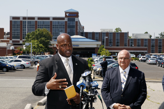Camden County Prosecutor's Office Capt. Ron Moten, left, stands with in front of Kennedy Hospital with hospital chief of safety, David Condoluci, as he answers a question about shootings at the fa ...