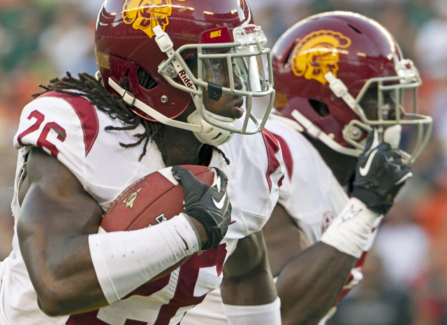 In this Aug. 29, 2013 file photo, Southern California cornerback Josh Shaw (26) runs back an interception for a touchdown against Hawaii during the second quarter of an NCAA college football game  ...