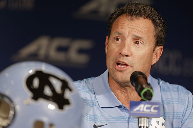 In this July 21, 2014, file photo, North Carolina coach Larry Fedora answers a question during a news conference at the Atlantic Coast Conference football kickoff in Greensboro, N.C. Fedora says t ...