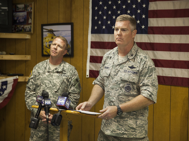 Brigadier General Timothy P. Williams, adjutant General of the Virginia National Guard, left, and Brigadier General Robert Brooks, component commander of the Massachusetts Air National Guard, answ ...