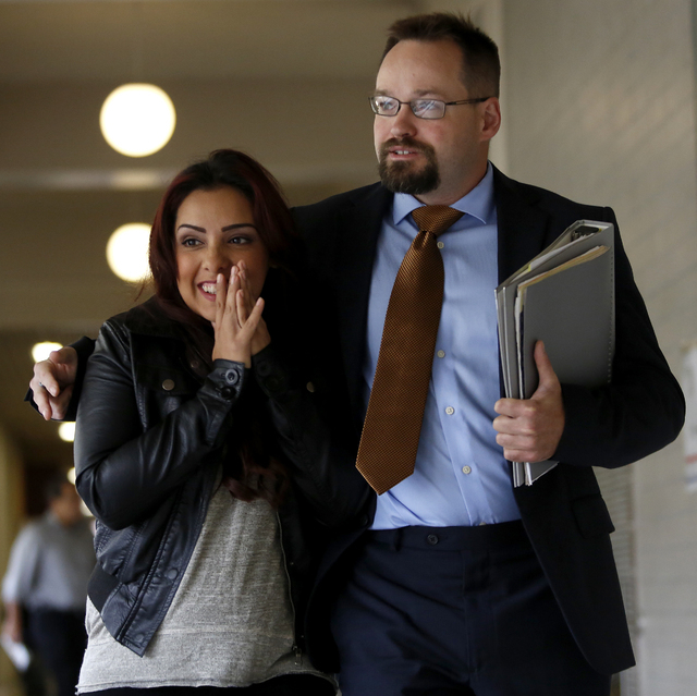 Delia Garcia-Bratcher and her attorney Ben Adams walk out of the Sonoma County Superior Court in Santa Rosa, Calif., on Thursday, Aug. 28, 2014. Prosecutors said they will not file charges against ...