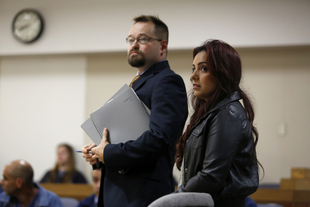 Delia Garcia-Bratcher, and her attorney Ben Adams listen to Chief Deputy District Attorney Bill Brockley at the Sonoma County Superior Court in Santa Rosa, Calif., on Thursday, Aug. 28, 2014. Pros ...
