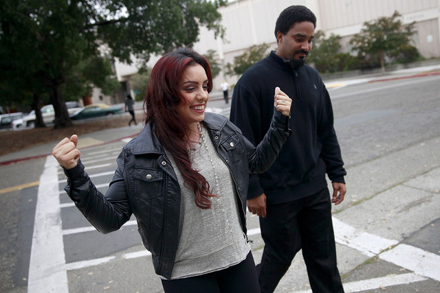 Delia Garcia-Bratcher, joined by her fiance Shaka Hay, reacts outside of the Sonoma County Superior Court in Santa Rosa, Calif., on Thursday, Aug. 28, 2014. Prosecutors said they will not file cha ...