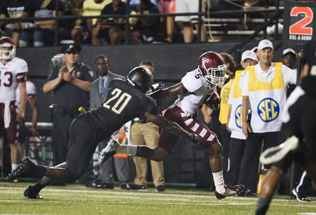 Temple's Jalen Fitzpatrick stiff-arm's Vanderbilt's Oren Burks on his way to a touchdown during the second quarter of an NCAA college football game Thursday, Aug. 28, 2014, in Nashville, Tenn. (AP ...