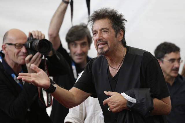 Actor Al Pacino poses for photographers during a photo call for the movie Manglehorn during the 71st edition of the Venice Film Festival in Venice, Italy, Saturday, Aug. 30, 2014. (AP Photo/David  ...