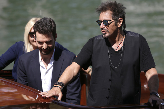 Actor Al Pacino, right, arrives on a boat for the press conference of the film The Humbling during the 71st edition of the Venice Film Festival in Venice, Italy, Saturday, Aug. 30, 2014. (AP Photo ...
